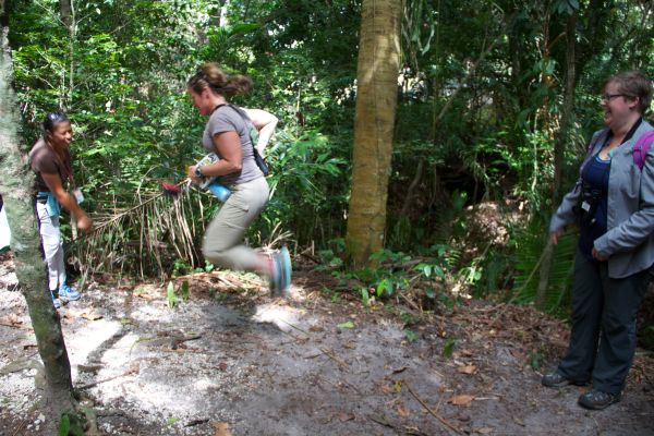 Jennifer jump-roping over a root from a Philodendron, turned by Annabelle and Kim